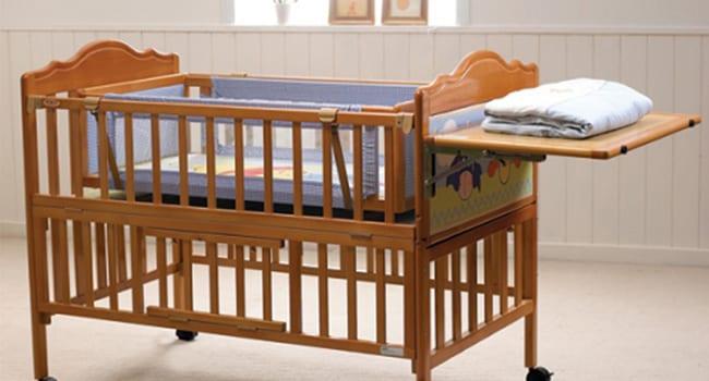 Кроватка-трансформер с откидной панелью